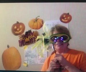 Ms. Rosado wearing Mardi Gras eye mask