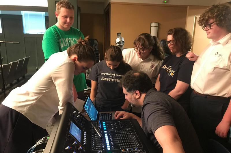 photo of students around a sound board
