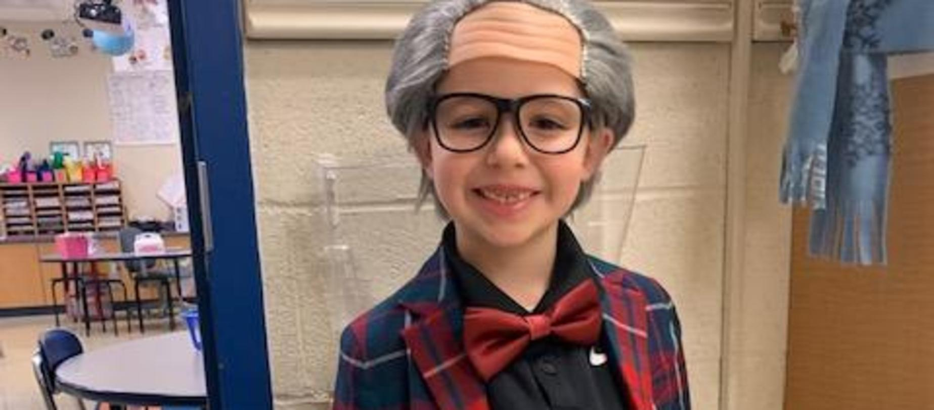 student dressed like he's 100 years old