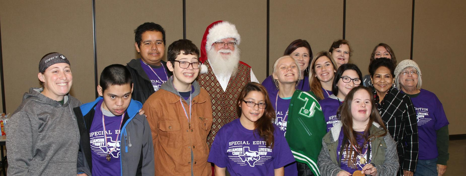Students and teachers with Santa.