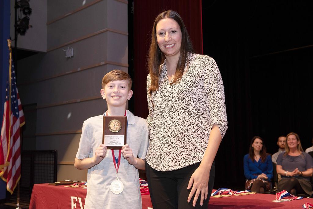 Teacher Christina Moreira and second-place finisherJason Spaulding