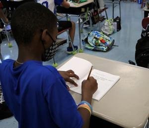 Photo of student writing in journal
