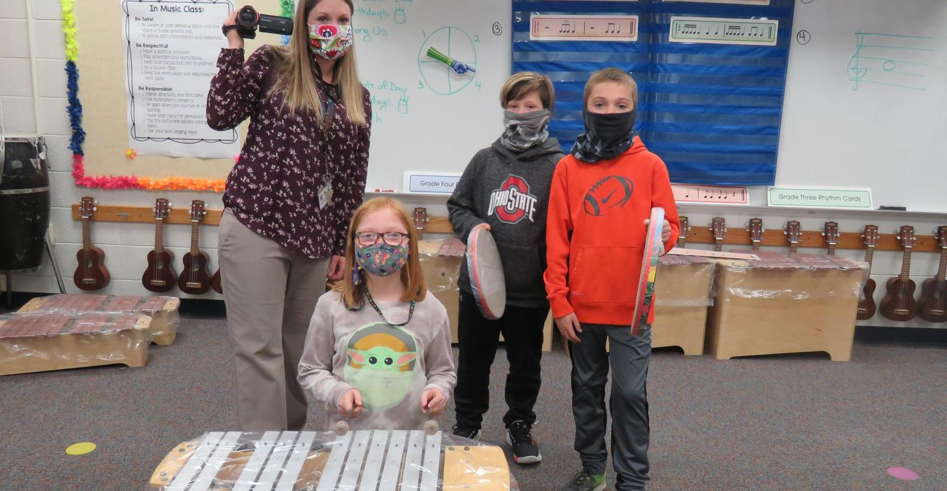 Page students check out new musical instruments thanks to a grant.