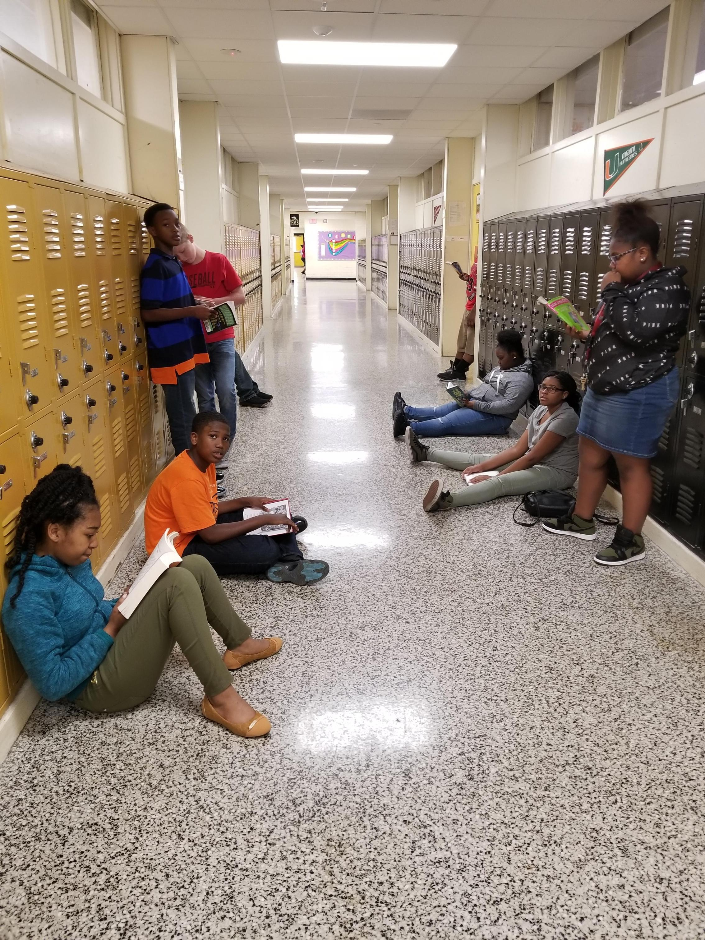 Students in hallway reading