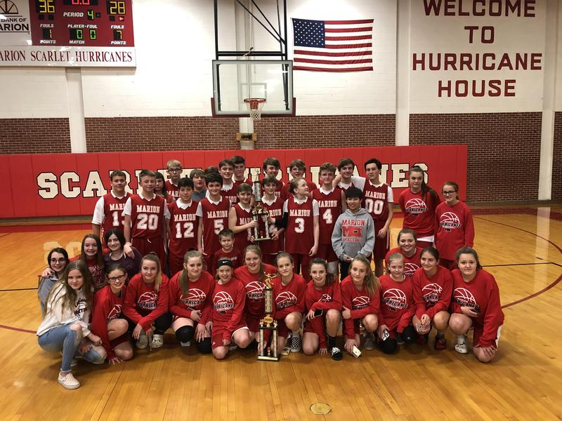 MMS Boys and Girls Basketball teams receiving trophies for winning Highlands Conference Tournament.