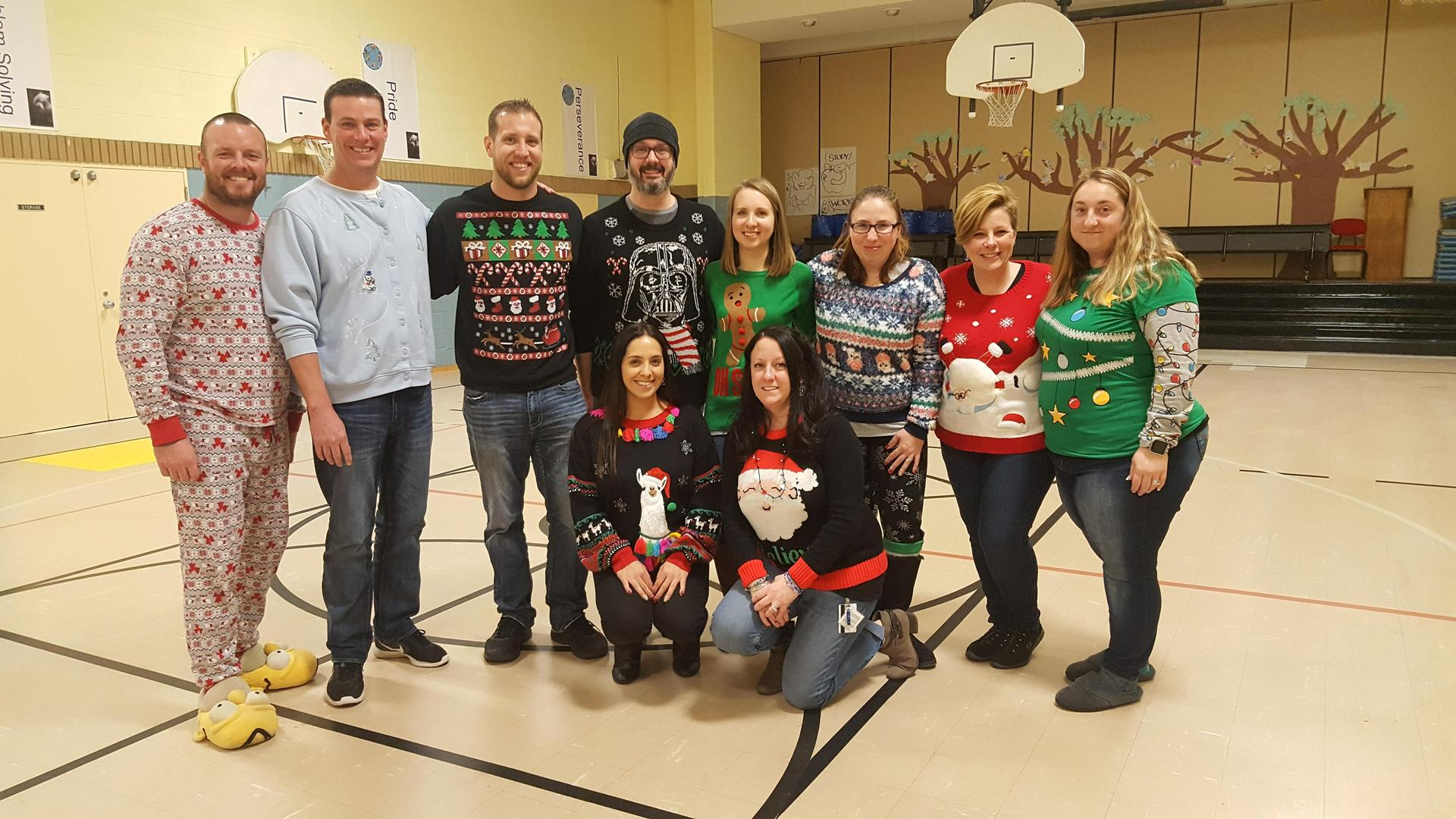 staff in Christmas sweaters