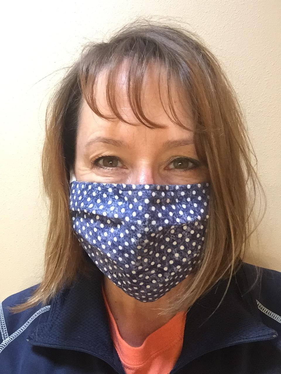Staff member in mask closeup selfie
