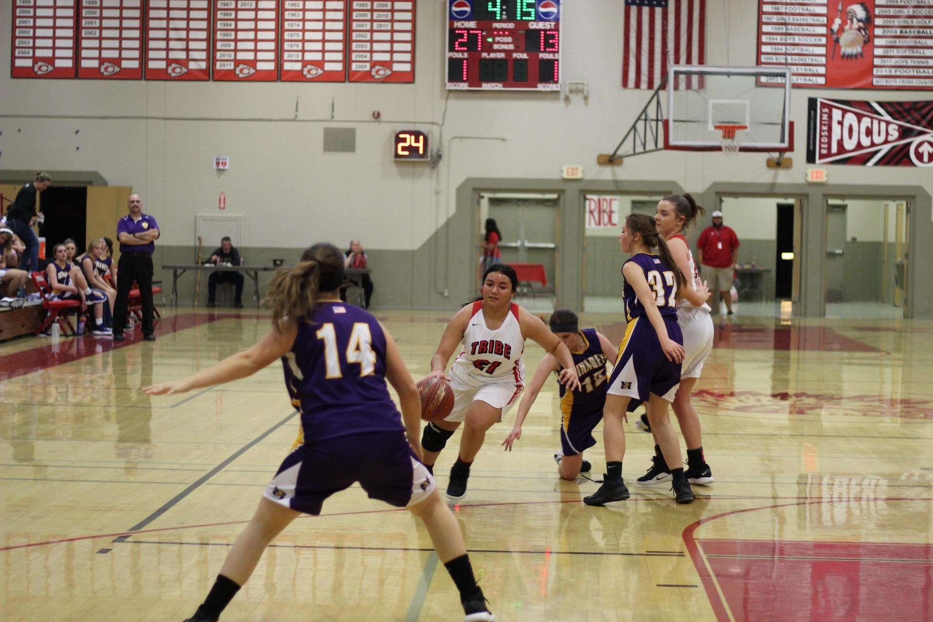 Erykah Negron dribbling the ball