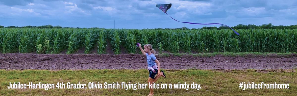 girl running thru fields