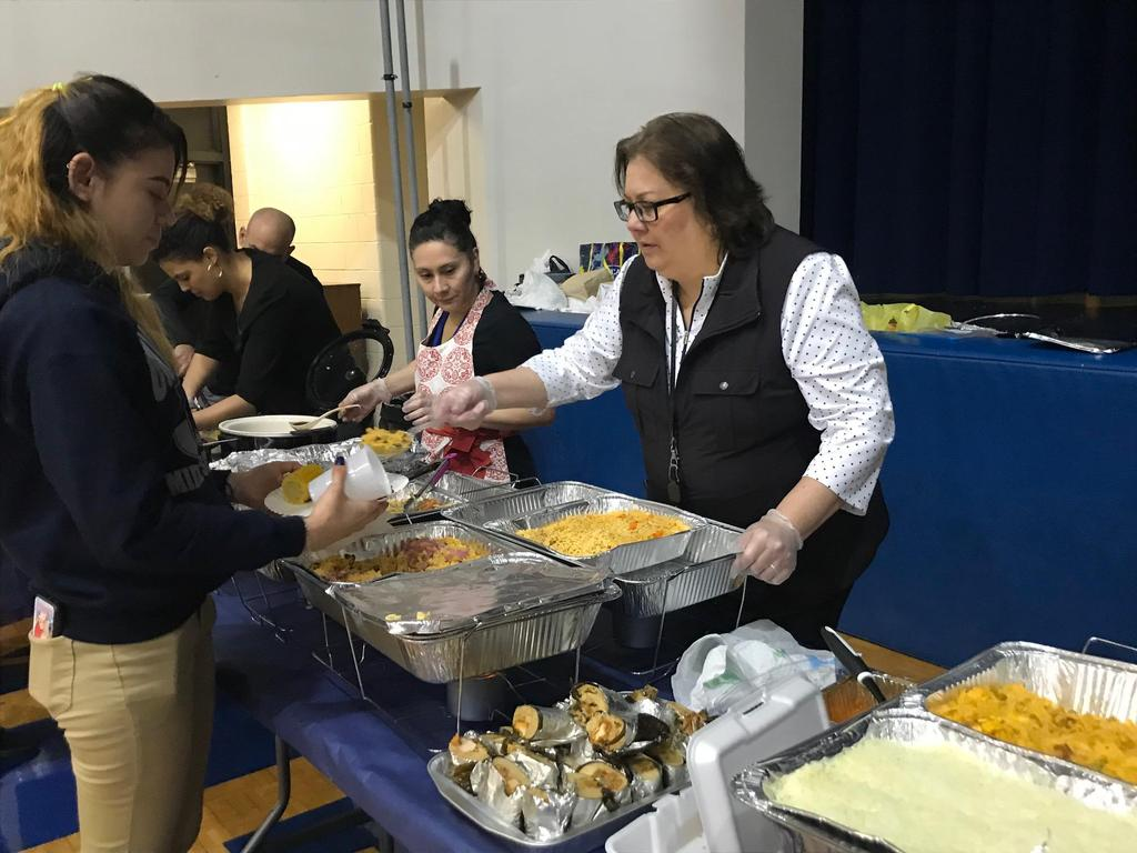 supervisor Rojas serving a student food