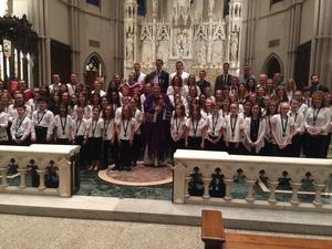 a group of students with Bishop Zubik at St. Paul's Cathedral after a concert