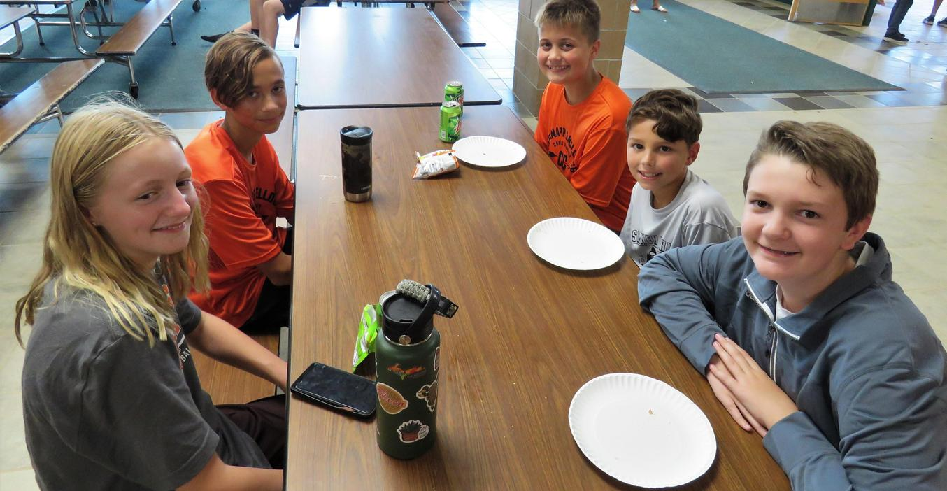 MS students enjoy eating pizza and being together at the activity night.