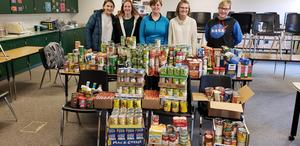 TKHS NHS students collect food items for local food pantries.