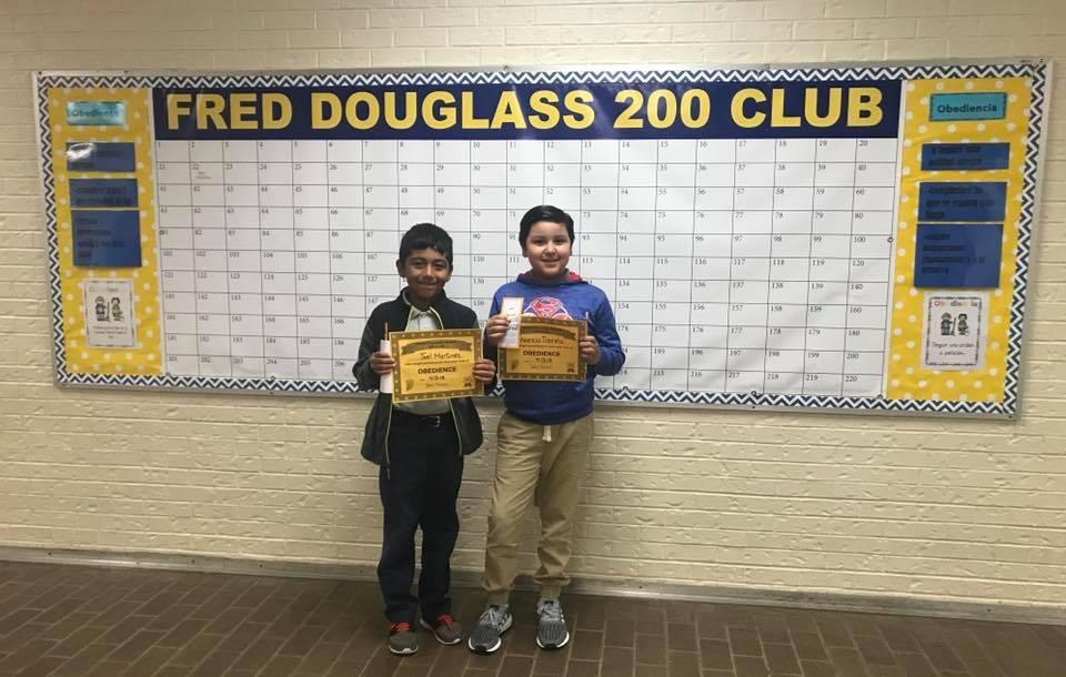 two students posing with certificates for 200 club