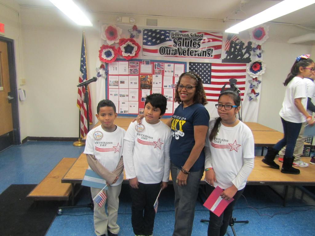 Ms. DeFransisco with three students at the veterans assembly