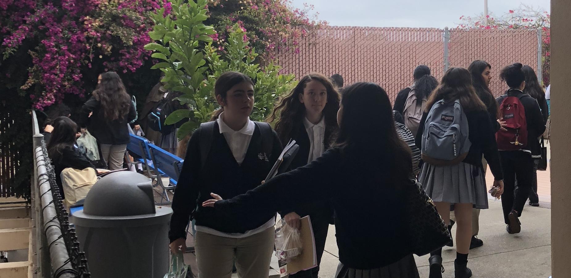 students walking outdoors between classes