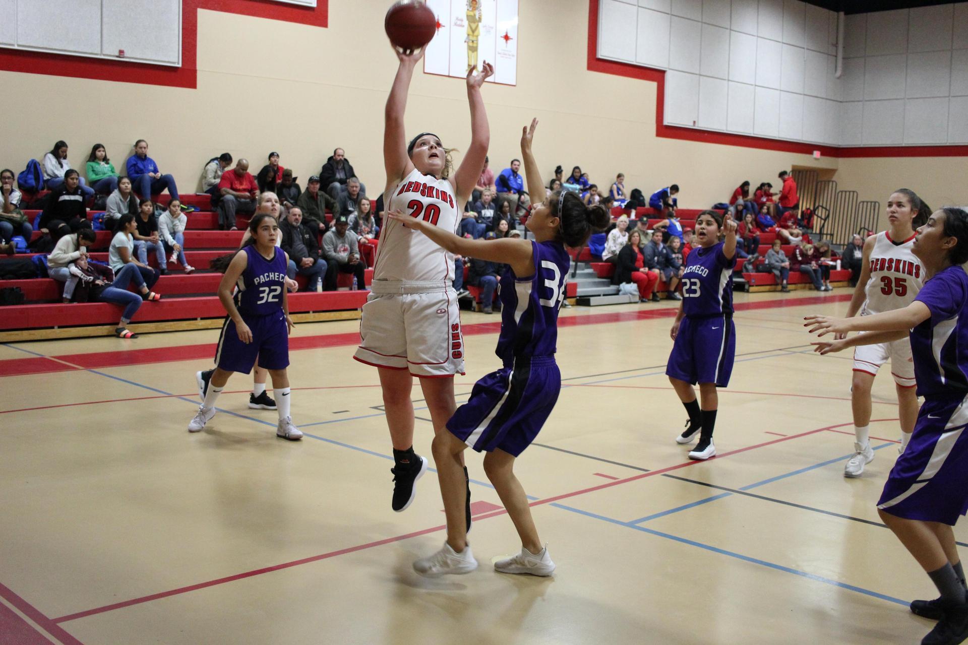 Junior Varsity girls playing basketball against Pacheco