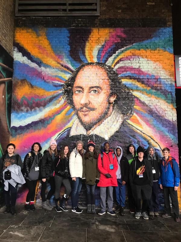 students in front of the Shakespeare mural in London