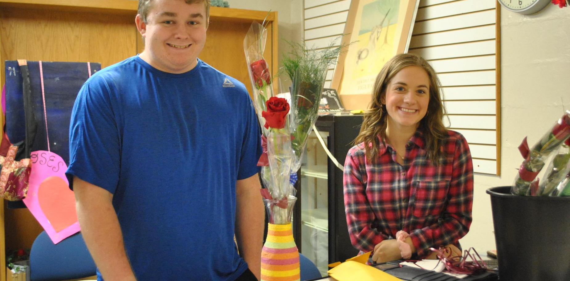 Students selling Valentine flowers