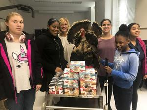 Students and staff with a full donation cart