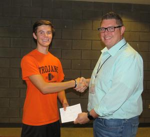 Turner Halle receives congratulations from high school principal Tony Petersen on being named a commended student.