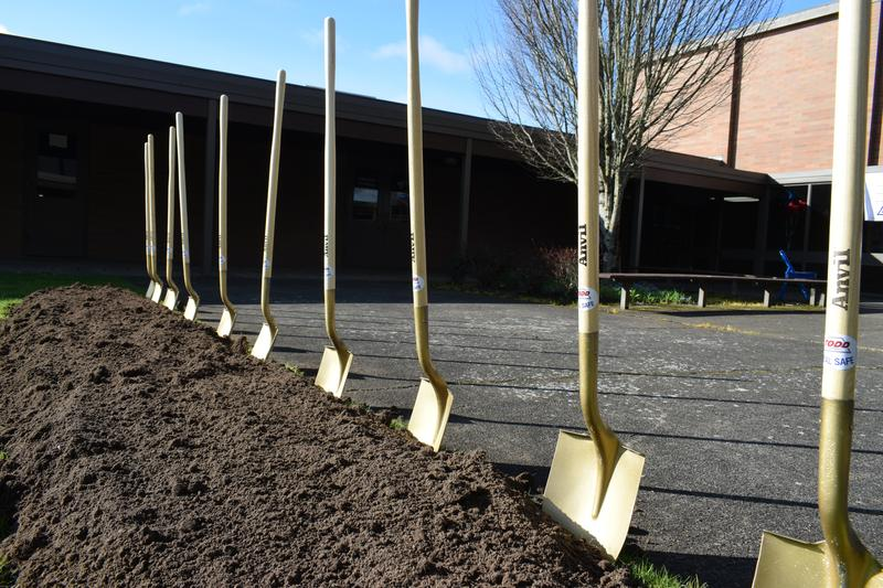 photos of shovels in ground