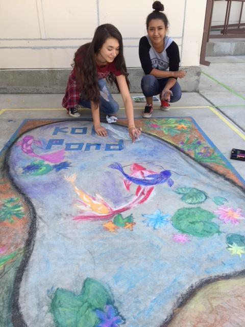 Mountain Heights Academy students showing there artistic ability by drawing a koi pond