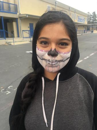 Student showing face paint