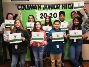 group of 9 students pose with student of the month certificates