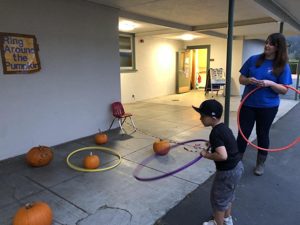 Ring around the pumpkin with student and teacher