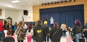 Families listening to Principal Johnson and Vice Principal Montano give a speech