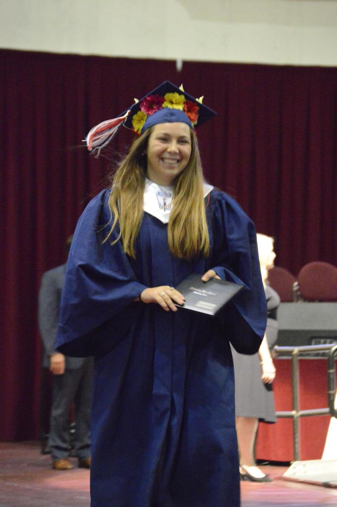 Female graduate in procession for WHS Graduation 2018