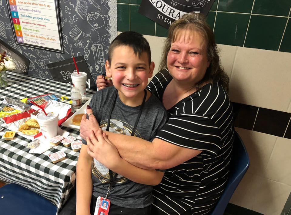 grandmother holds grandson