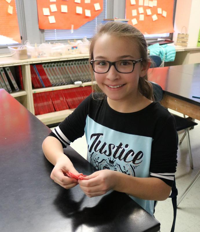 The Good Vibes Tribe at Edison Intermediate School made 1,000 origami peace cranes for Children's Specialized Hospital.  Pictured here is one student making the origami crane.