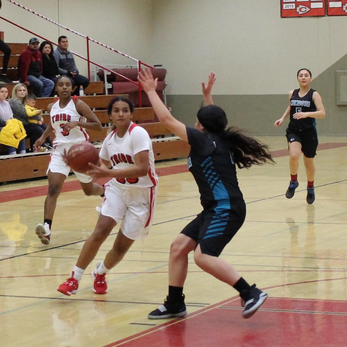 girls playing basketball against Mendota