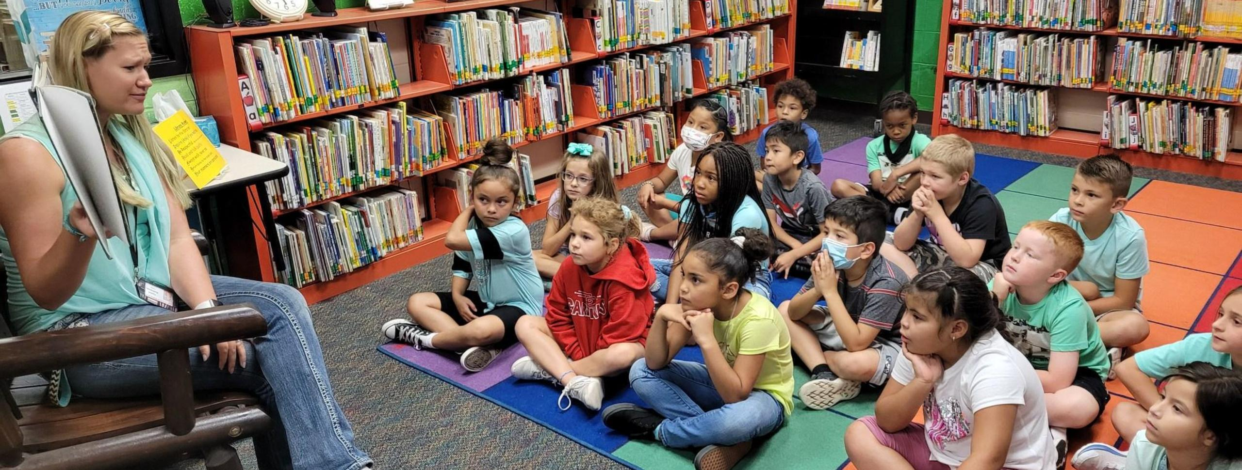 Picture of librarian reading to students