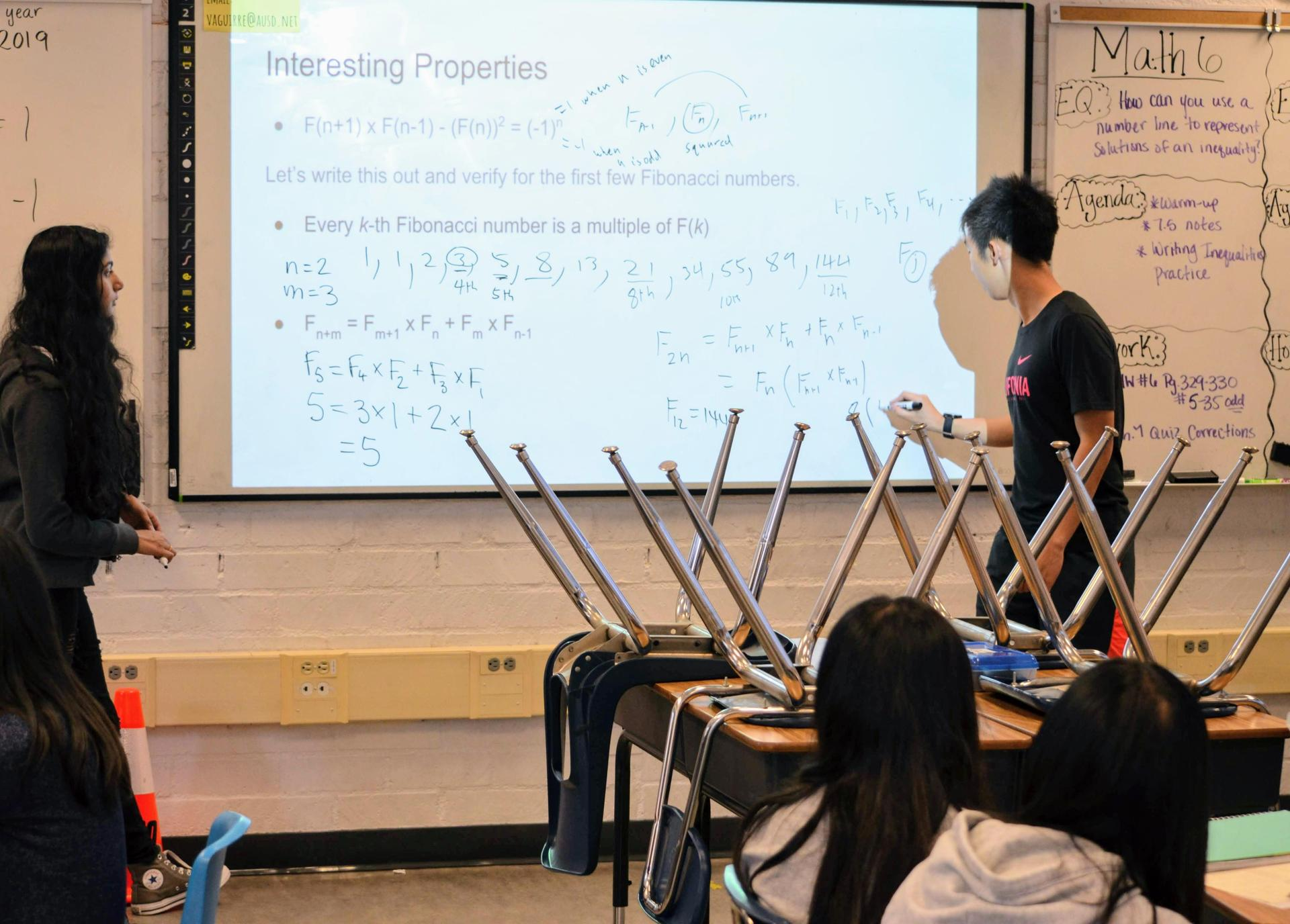 Prabhutendolkar working alongside Arcadia Math Circle teacher/Arcadia High sophomore Merrick Hua.