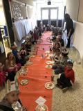 Mrs. Reid's class and Kindergarten enjoying a Thanksgiving fest.