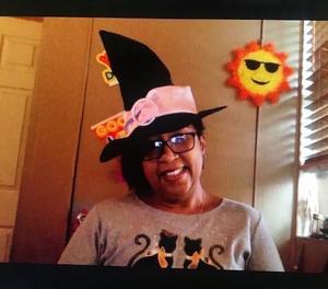 Ms. Matos wearing witch hat