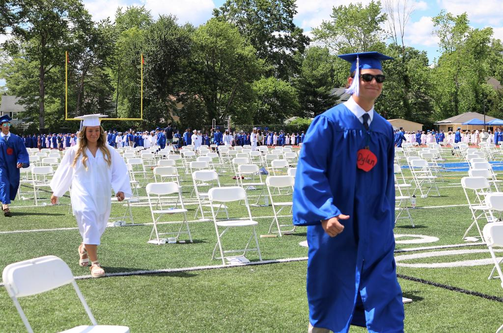 Photo of smiling 12th graders processing in for Class of 2021 commencement exercises.