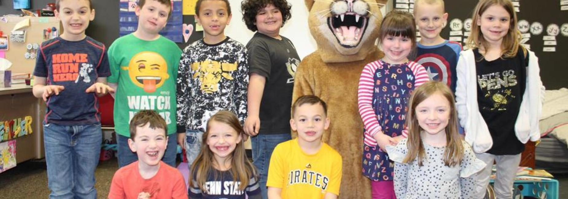 students lined up with mascot