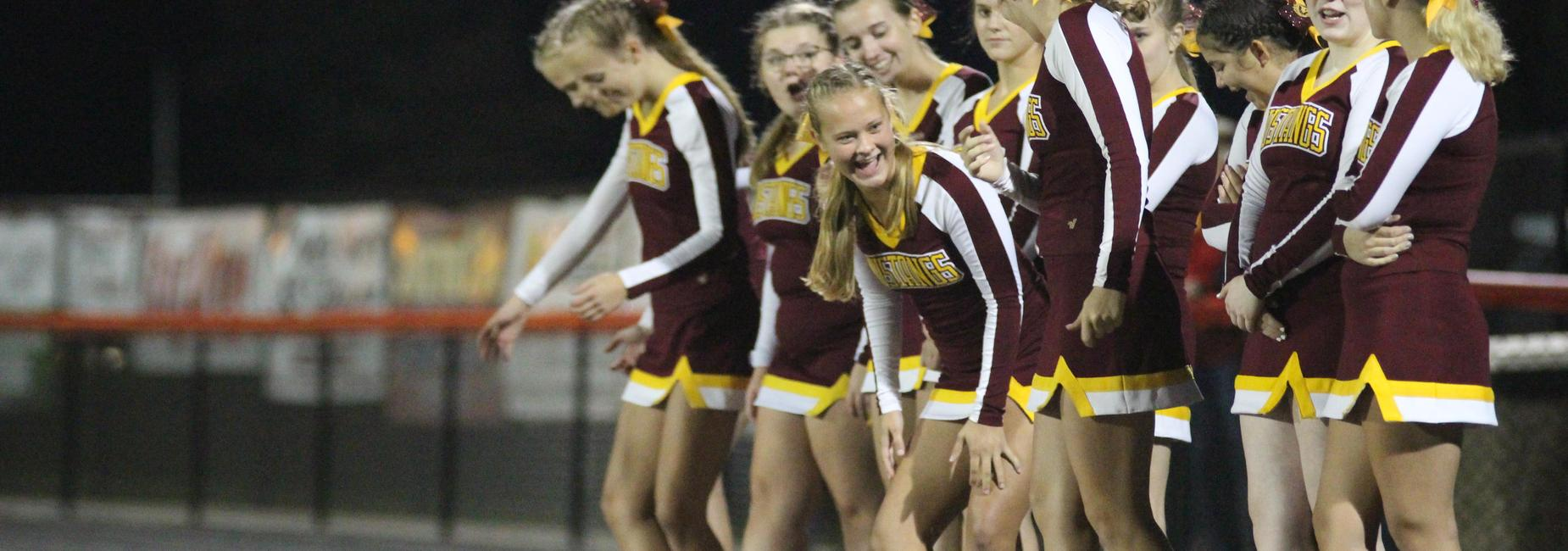 Cheerleaders laughing