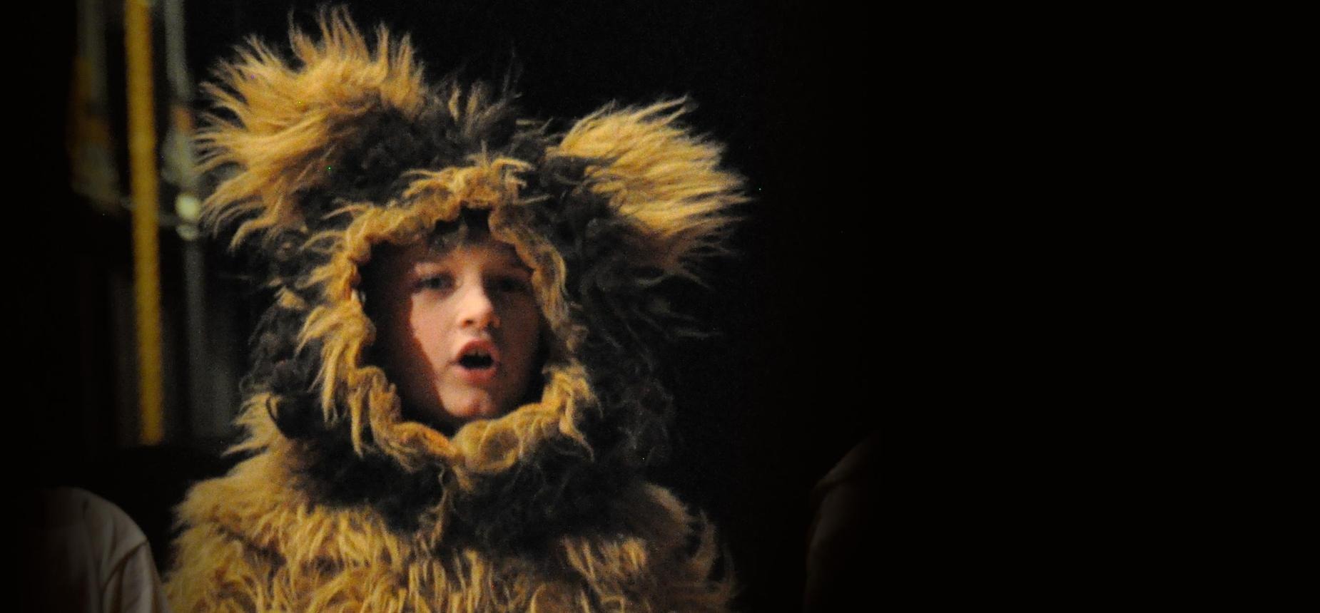 A character dressed as a lion in the elementary play