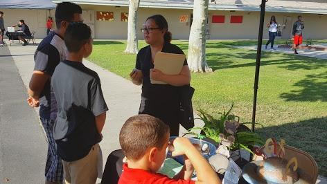 A teacher speaking with students.