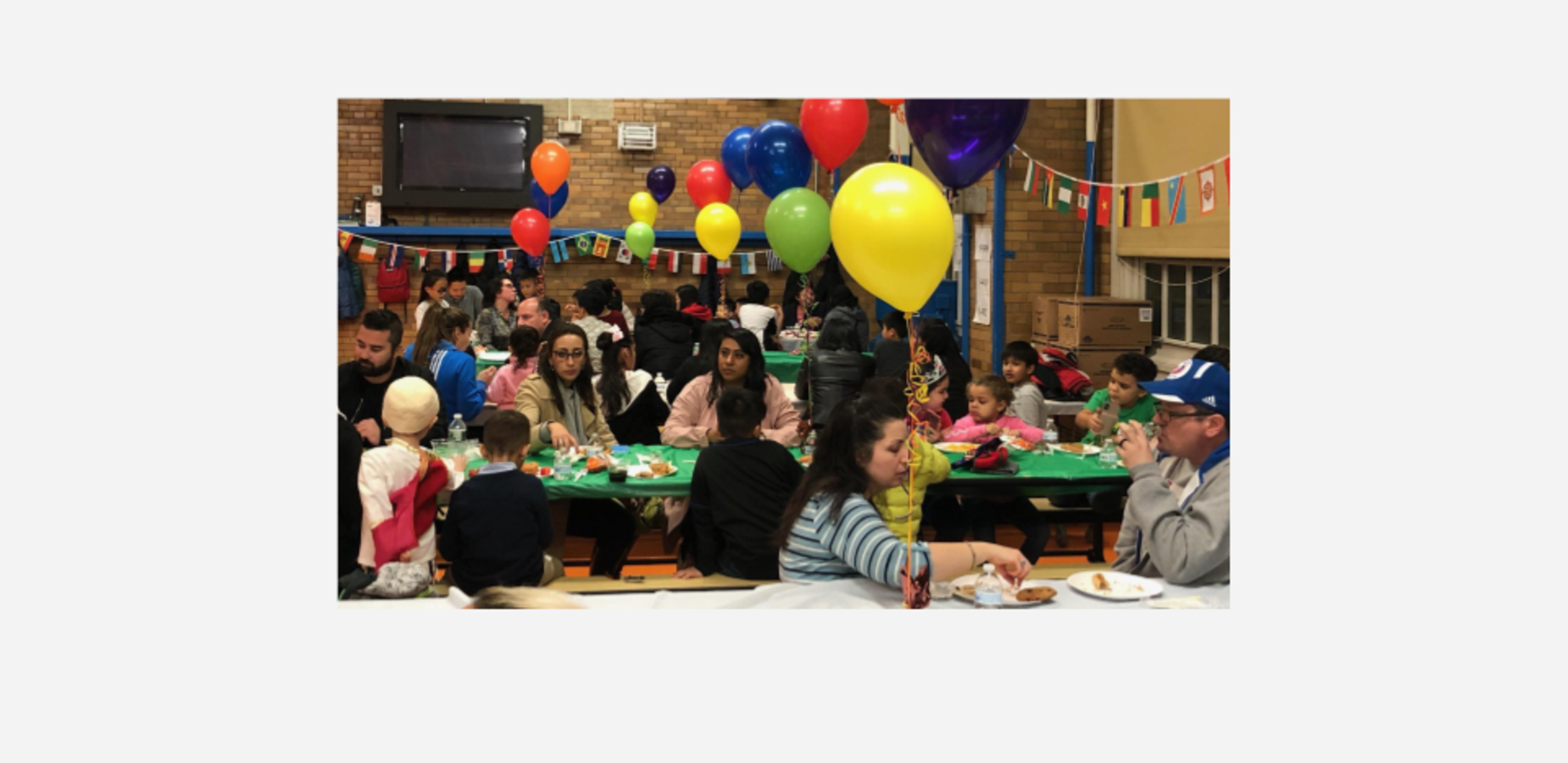 Families at multi-culture night celebration.