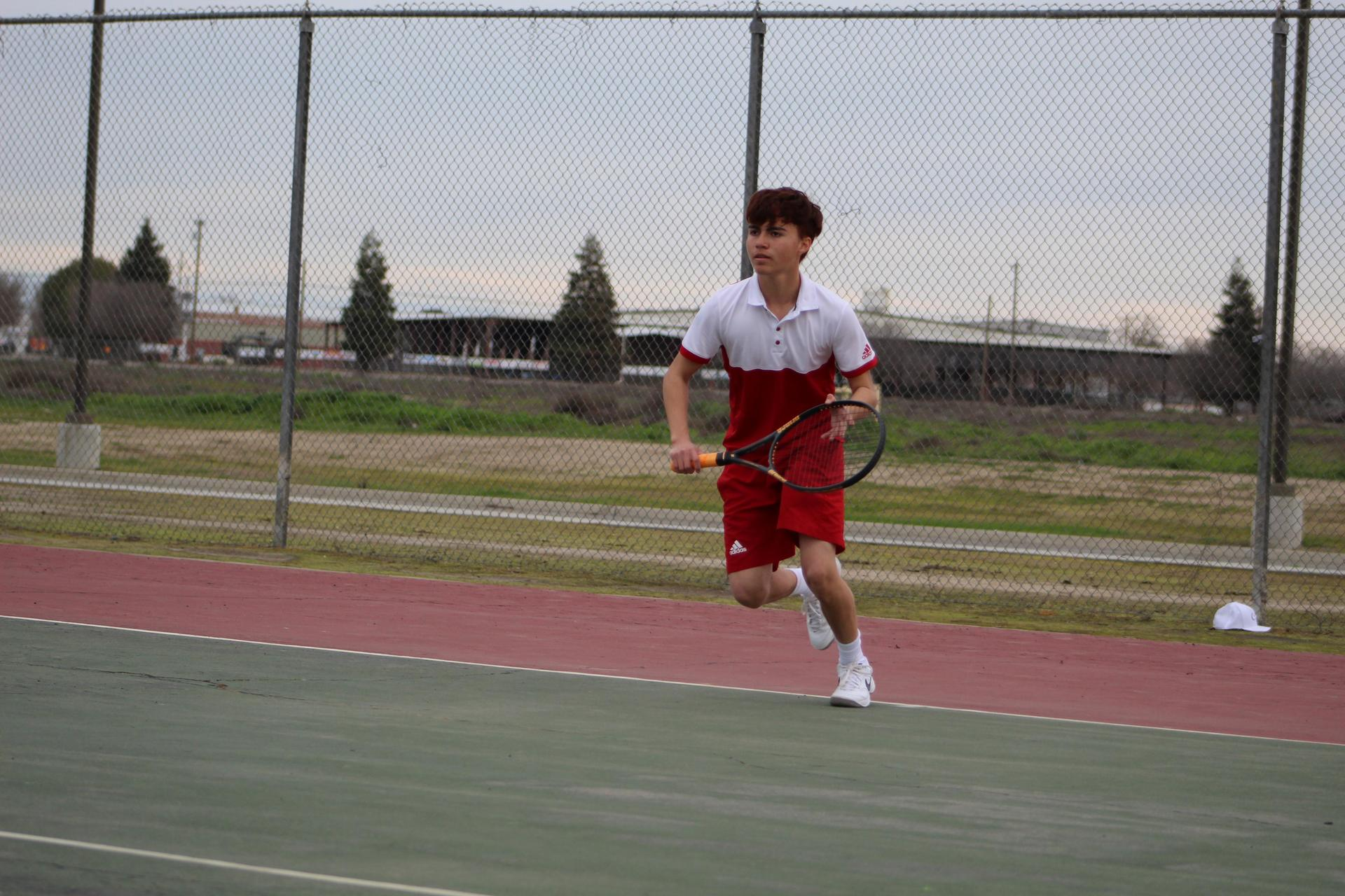 Chowchilla high school boys playing tennis against Firebaugh