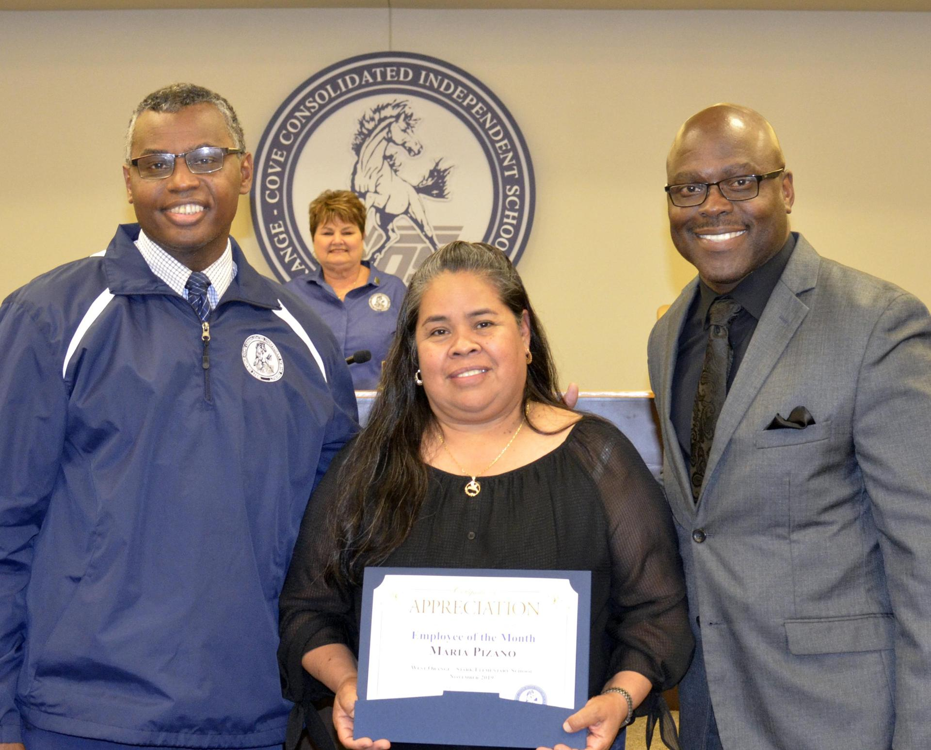 Maria Pizano,Employee of the Month for November, pictured with Principal Dr. Bethley and Superintendent Dr. Harris