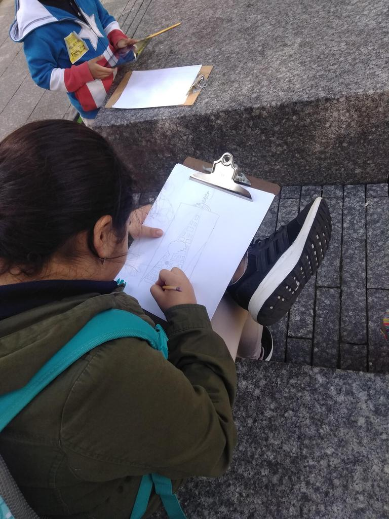 close up a girl drawing the freedom tower