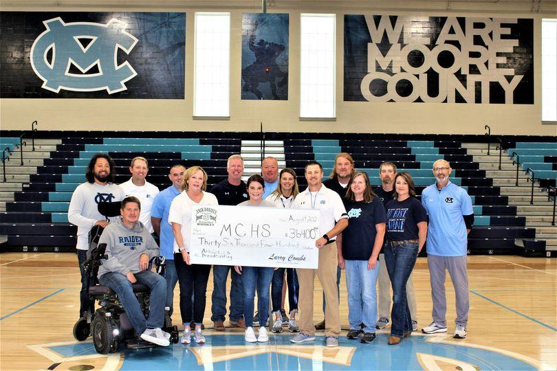 Jack Daniels presenting a check to MCHS Athletics
