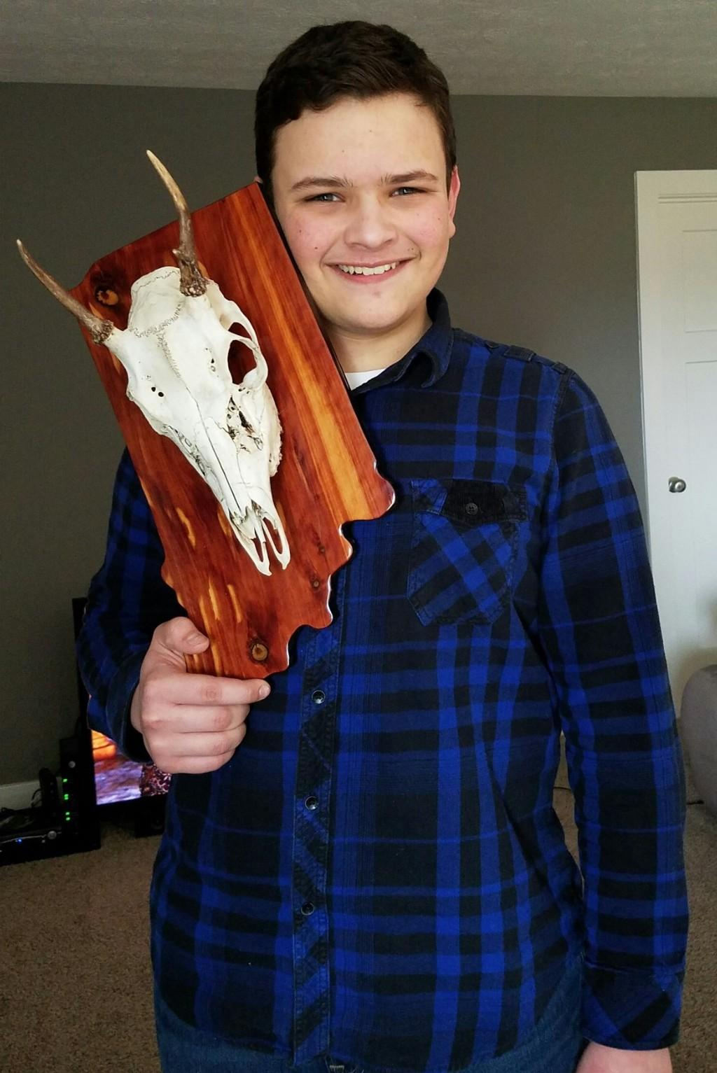 Student with skull on wood.